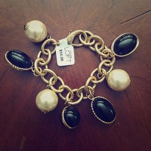 Gold Tone Bracelet with Black and Pearl Baubles.